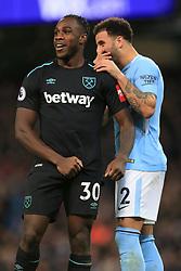 3rd December 2017 - Premier League - Manchester City v West Ham United - Kyle Walker of Man City jokes with Michail Antonio of West Ham - Photo: Simon Stacpoole / Offside.