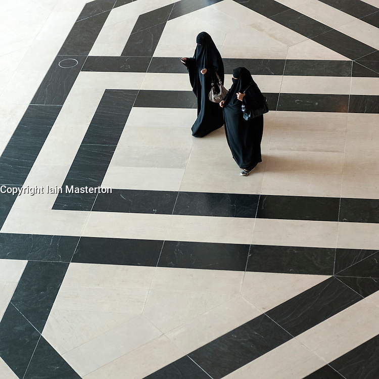 Two Arab women visiting the  of Museum of Islamic Art in Doha Qatar
