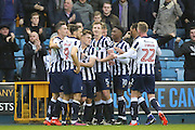 Millwall striker Steve Morison (20) celebrating with team matrs after scoring 1-0 during the The FA Cup 3rd round match between Millwall and Bournemouth at The Den, London, England on 7 January 2017. Photo by Matthew Redman.