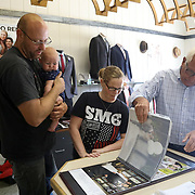 Brandon Brown, left, and Melissia Montague, center, with William Brown, 3 months, all of West Unity, look through wedding clothing options for their wedding with Tim Smith at Lauber Clothing in Archbold, Ohio, on Wednesday, July 25, 2018. THE BLADE/KURT STEISS