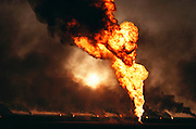 The afternoon sun weakly shines though the smoke of the burning Magwa oil fields near Ahmadi in Kuwait after the end of the Gulf War. (May, 1991). More than 700 wells were set ablaze by retreating Iraqi troops creating the largest man-made environmental disaster in history.