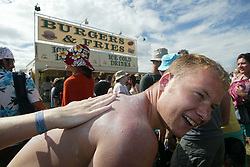 Fans pictured on Sunday 10th July, 2005 at the two-day T in the Park festival, at Balado, Kinross-shire, Scotland..