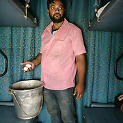 Peddler selling Boiled Eggs.Throughout the journey, peddlers pop into the train compartments with all sorts of offerings,  to be bargained for a few rupees.<br /> Inside the Dibrugarh-Kanyakumari Vivek Express, the longest train route in the Indian Subcontinent. It joins Kanyakumari, Tamil Nadu, which is the southernmost tip of mainland India to Dibrugarh in Assam province, near the border with Burma.