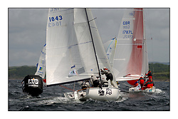 Yachting- The first days inshore racing  of the Bell Lawrie Scottish series 2002 at Tarbert Loch Fyne. Near perfect conditions saw over two hundred yachts compete. <br />Wet 'n'  Black (IRL1843) follows the Big L (GBR1787L) round the windward mark.<br />1720<br /><br />Pics Marc Turner / PFM