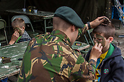 June 28, 2014 - Weert, Limburg, Netherlands - Dutch Army Young Recruiters painting children's faces on Military Camouflage — Weert, is the Dutch city in south-eastern corner of Netherlands, otherwise it belongs to the Limburg province. It received the rights of being a city back in 1414, six hundred years ago. June's weekend marked the three days of military, fire rescue, ambulances, as well as biking, riot and dog squads of police drills in the centre of the city. (Credit Image: © Vedat Xhymshiti/ZUMA Wire)