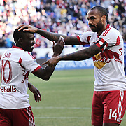 Thierry Henry, (right), New York Red Bulls, points to team mate LLoyd Sam who provided the assist for his goal during the New York Red Bulls V Colorado Rapids, Major League Soccer regular season match at Red Bull Arena, Harrison, New Jersey. USA. 15th March 2014. Photo Tim Clayton
