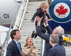 Canadian Ambassador to Ireland Kevin Vickers tosses Hadrien Trudeau into the air as Prime Minister Justin Trudeau and his wife, Sophie Gregoire Trudeau, look on after arriving in Dublin, Ireland, Monday, July 3, 2017.Photo by Ryan Remiorz/CP/ABACAPRESS.COM