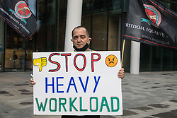 A night-shift cleaner belonging to the Cleaners and Allied Independent Workers Union (CAIWU) protests outside the UK headquarters of Facebook on 5th August 2021 in London, United Kingdom. Cleaners are outsourced via the Churchill Group to clean the Facebook offices and CAIWU claims that five additional floors have been added to their workload, that cleaners who have left have not been replaced and that sickness and holiday cover has not been provided.