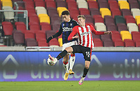 Middlesbrough's Marcus Tavernier and Brentford's Marcus Forss<br /> <br /> Photographer Rob Newell/CameraSport<br /> <br /> The Emirates FA Cup Third Round - Brentford v Middlesbrough - Saturday 9th January 2021 - Brentford Community Stadium - Brentford<br />  <br /> World Copyright © 2021 CameraSport. All rights reserved. 43 Linden Ave. Countesthorpe. Leicester. England. LE8 5PG - Tel: +44 (0) 116 277 4147 - admin@camerasport.com - www.camerasport.com