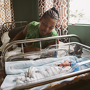 INDIVIDUAL(S) PHOTOGRAPHED: Fernande Delice (left) and Emmanuelo Wariens (right). LOCATION: St. Damien Hospital, Nos Petits Frères et Sœurs, Tabarre 41 Commune, Haïti. CAPTION: Fernande Delice watches over her newborn baby, Emmanuelo. He is her third-born child.