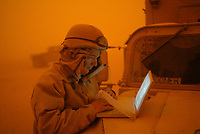 Jack Gruber transmits to USA TODAY during blinding sand storm during the 2003 Iraq Invasion.