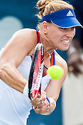 Germany's Angelique Kerber hits a return to  USA's Melanie Oudin during their women's singles match at the Citi Open ATP tennis tournament in Washington, DC, USA, 1 Aug 2013. Kerber won the match 7-5, 6-0 to advance.