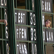 A young boy peers out from the scoreboard during the match between New Zealand and Pakistan in the Super 6 stage of the ICC Women's World Cup Cricket tournament at Drummoyne Oval, Sydney, Australia on March 19, 2009. New Zealand won the match by 223 runs. Photo Tim Clayton