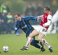 MILANO 25/11/2003 <br />Champions League Inter Arsenal 1-5<br />Ray Parlour (Arsenal) contrasta Andy Van Der Meyde (Inter)<br />Ray Parlour (Arsenal) challenges Andy Van Der Meyde (Inter)<br />Photo Andrea Staccioli GRAFFITI
