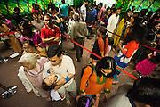 Thousands wait in line to participate in prayer, celebration, and eating during Diwali at the Shreemaya Krishnadham Temple in Milpitas, California, on November 10, 2013. (Stan Olszewski/SOSKIphoto)