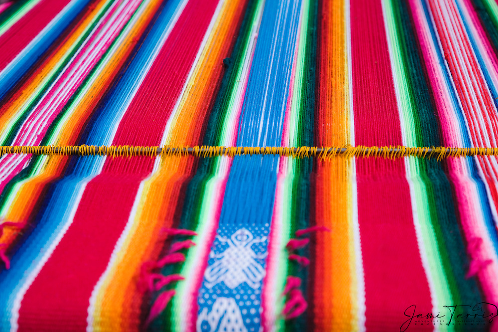 A traditional Bolivian blanket on the weaving loom, Lago Titicaca, Bolivia,South America