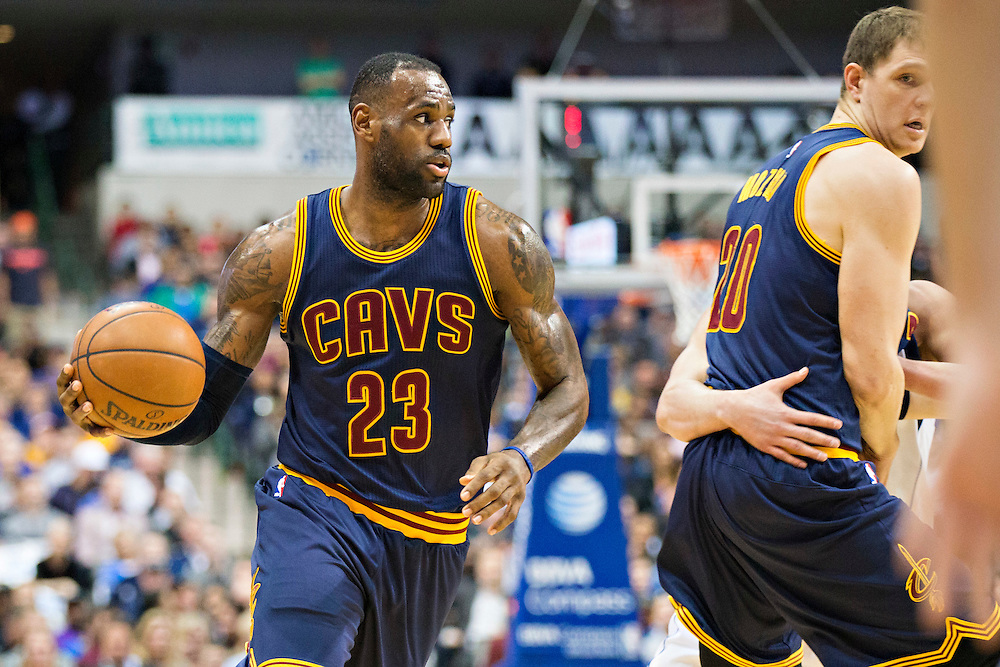 DALLAS, TX - JANUARY 12:  Lebron James #23 dribbles around a pick set by Timofey Mozgov #20 of the Cleveland Cavaliers during a game against the Dallas Mavericks at American Airlines Center on January 12, 2016 in Dallas, Texas.  NOTE TO USER: User expressly acknowledges and agrees that, by downloading and or using this photograph, User is consenting to the terms and conditions of the Getty Images License Agreement.  The Cavaliers defeated the Mavericks 110-107.  (Photo by Wesley Hitt/Getty Images) *** Local Caption *** Lebron James; Timofey Mozgov