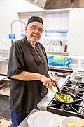 Working senior man in kitchen.
