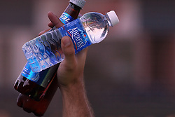 11 July 2012:  A vendor in the stands displays the water and beer he is selling during the Frontier League All Star Baseball game at Corn Crib Stadium on the campus of Heartland Community College in Normal Illinois