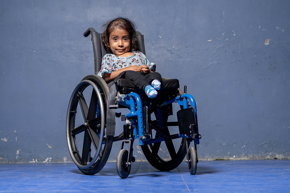 Wheelchair basketball and Jessica at the Gymnasium. Jessica 6yrs old, suffers from spina bifida in Santa Rosa de Copan, Copan on Sunday, February 23, 2020. Jessicas mother left her soon after she was born.     Photo by Ken Cedeno