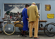 © Licensed to London News Pictures. 14/09/2012. Goodwood, UK People enjoy the atmosphere at the 2012 Goodwood Revival Meeting today 14 September 2012. The event recreates the glorious days of motor racing and participants are encouraged to dress in period dress. Photo credit : Stephen Simpson/LNP