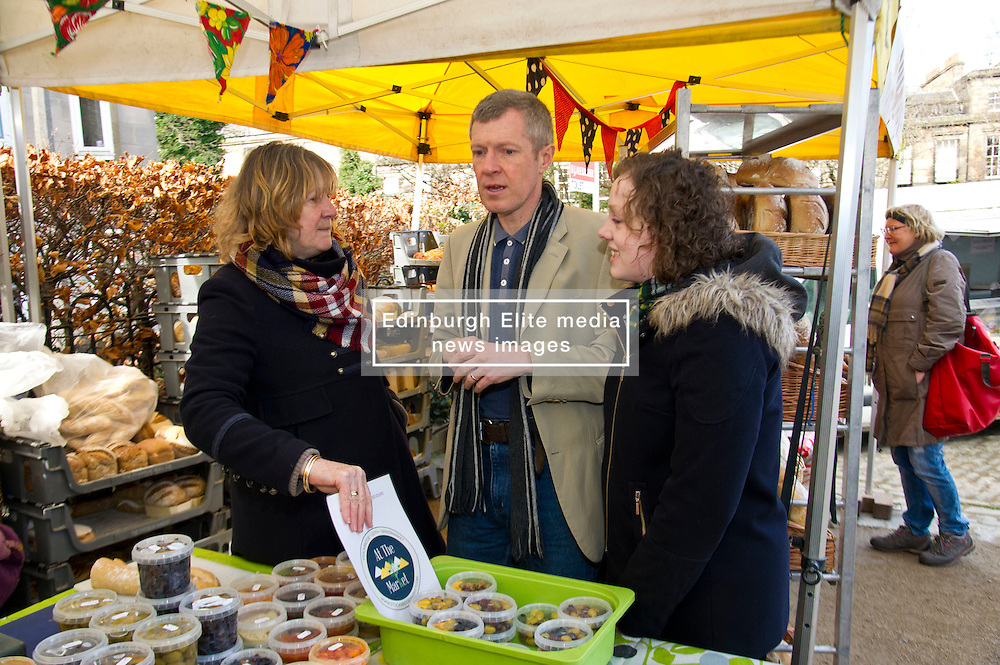Pictured: Beth Berry, organiser of the Three Edinburgh Farmers markets, Willie Rennie and Hannah Bettsworth, Liberal Democrat candidate for Edinburgh Central and the Lothian regional list<br /> <br /> Liberal Democrat leader Willie Rennie and  Hannah Bettsworth, Liberal Democrat candidate for Edinburgh Central and the Lothian regional list, headed to Stockbridge today to meet Easter shoppers and stallholders at the Sunday farmers market. <br /> <br /> Ger Harley   EEm 27 March 2016