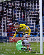 Jake Bidwell of Brentford scores an own goal during the Sky Bet Championship match at the John Smiths Stadium, Huddersfield<br /> Picture by Graham Crowther/Focus Images Ltd +44 7763 140036<br /> 06/12/2014