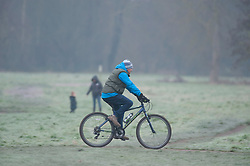 © Licensed to London News Pictures. 10/01/2019. Sidcup, UK. A cyclist braving the early frost at Footscray Meadows,Sidcup. Freezing cold weather this morning in South East London. Photo credit: Grant Falvey/LNP