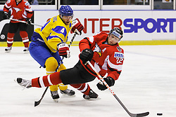 25.04.2010, Eishalle, IJssportcentrum, Tilburg, NED, IIHF Division I WM, Gruppe A, Österreich vs Ukraine im Bild Thomas Pock is checked by Dmytro Tolkunov, EXPA Pictures © 2010, PhotoCredit/ EXPA/ Fintan Planting / SPORTIDA PHOTO AGENCY