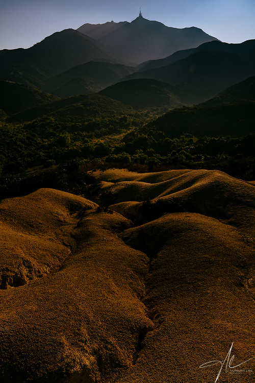 The area near castle peak of Hong Kong is filled with amazing landscape due to soil erosion.  This is captured when the morning sun casted beautiful shadow on those erosed slope.