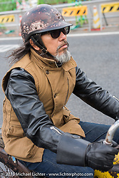 """""""Sushi"""" Atsushi Yasui on a ride around Tokyo with friends of the Freewheelers And Company shop, Japan. December 8, 2015.  Photography ©2015 Michael Lichter."""