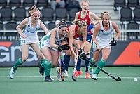 AMSTELVEEN -  Lily Owsley (Eng) met Roisin Upton (Ier) , Hannah Matthews (Ier)  en keeper Sabbie Heesh (Eng)   tijdens de wedstrijd dames , Ierland-Engeland (1-5) bij het  EK hockey , Eurohockey 2021.COPYRIGHT KOEN SUYK