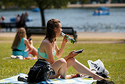 © Licensed to London News Pictures. 20/07/2016. London, UK. People sunbathe and enjoy hot weather in Hyde Park, London as temperatures hit 27C degrees across the capital on Wednesday, 20 July 2016. Photo credit: Tolga Akmen/LNP