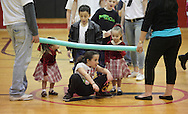 Middletown, New York - A girl goes under the foam bar during a limbo contest at Family Night at the Middletown YMCA on April 2, 2011.