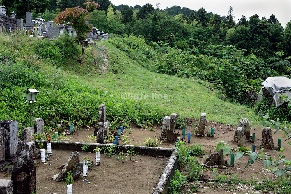 old and new graveyard in rural setting Japan Hiroshima prefecture