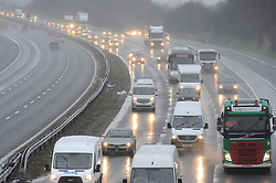 © Licensed to London News Pictures. 22/02/2016<br /> Heavy traffic (CLOCK-WISE TOWARDS SEVENOAKS) and wet weather on the M25 in Kent at J3 for Swanley.<br />  <br />  (Byline:Grant FalveyLNP)