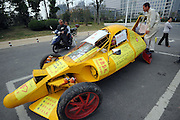 HEFEI, CHINA - OCTOBER 21: China Out - Finland Out<br /> <br /> Home-made Sports Car<br /> <br /> 47-year-old Zhu Runqiang poses with his home-made sports car on October 21, 2013 in Hefei, Anhui Province of China. The three-wheeled automobile weighs more than one ton with most of the car parts taken from junk cars. It can reach a maximum speed of 60 kilometer per hour, and cost Zhu about 50,000 yuan (8,204 USD). The computer installed car drifts and swings due to its front suspension system, said Zhu. He started his nationwide cruise from Hubei's Wuhan during the National Day holiday. <br /> ©Exclusivepix