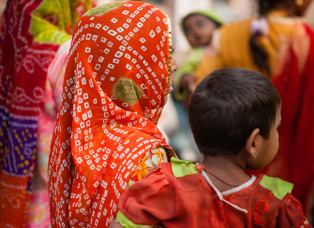 Indian woman in red sari with son (India)