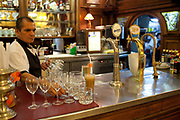 Waiters in Cafe Tortoni, which is famous for it's rude waiting staff, Buenos Aires, Federal District, Argentina.