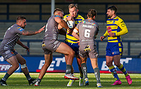 Warrington Wolves' Blake Austin is tackled by Catalans Dragons' Mike McMeeken and James Maloney<br /> <br /> Photographer Alex Dodd/CameraSport<br /> <br /> Rugby League - Betfred Challenge Cup Quarter Finals - Catalans Dragons v Warrington Wolves - Friday 7th May 2021 - Emerald Headingley Stadium - Leeds<br /> <br /> World Copyright © 2021 CameraSport. All rights reserved. 43 Linden Ave. Countesthorpe. Leicester. England. LE8 5PG - Tel: +44 (0 116 277 4147 - admin@camerasport.com - www.camerasport.com