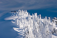 Backcountry skiers on the summit of Huntoon Point, Heather Meadows Recreation Area North Cascades Washington USA
