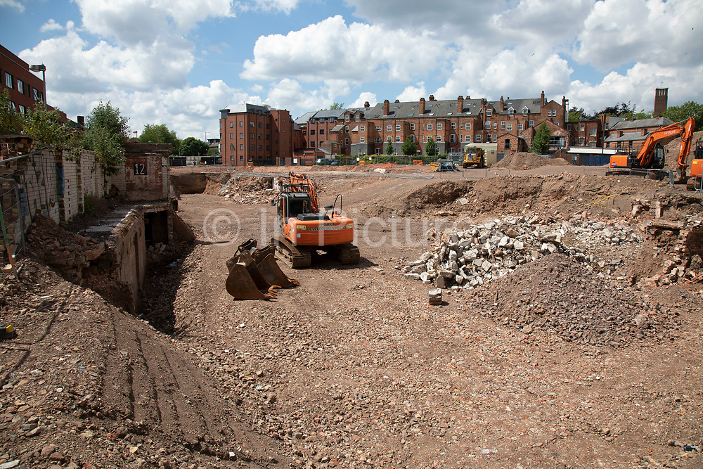 Construction site where redevelopment is taking place in the city centre on 15th June 2020 in Birmingham, United Kingdom.  The city is under a long term and major redevelopment, with much of its industrial past being demolished and made into new flats for residential homes.