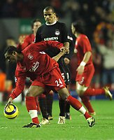 Photo: Javier Garcia/Back Page Images Mobile +447887 794393 Liverpool v Olimpiacos, UEFA Champions League 08/12/04, Anfield<br />Florent Sinama Pongolle plants the ball in the centre spot in front of Rivaldo after his goal spurred the Liverpool comeback