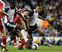 Photo: Daniel Hambury.<br />Tottenham Hotspur v Fulham. The Barclays Premiership.<br />26/09/2005.<br />Tottenham's Ledley King (R) and Jermaine Jenas combine to stop Fulham's Steed Malbranque.