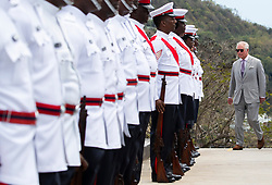 The Prince of Wales inspects the troops during the Official Welcome Ceremony and Reception with the Prime Minister Dr. Keith Mitchell at the Grenada Houses of Parliament Building during a one day visit to the Caribbean island of Grenada.