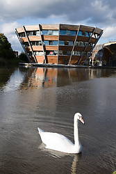 Jubilee University Campus; with a swan on the lake in the foreground,  A new modern design building in the city of Nottingham,