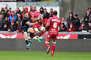 Josh Macleod of the Scarlets is tackled in the air by Rory Scannell of Munster.  Guinness Pro12 rugby match, Scarlets v Munster at the Parc y Scarlets in Llanelli, West Wales on Saturday 3rd September 2016.<br /> pic by  Andrew Orchard, Andrew Orchard sports photography.