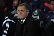 file pic Garry Monk has been sacked as Swansea manager on 9/12/2015. Swansea city manager Garry Monk looks on from the dugout. Barclays Premier league match, Swansea city v Leicester city at the Liberty Stadium in Swansea, South Wales on Saturday 5th December 2015.<br /> pic by  Andrew Orchard, Andrew Orchard sports photography.