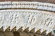 13th century Romanesque decorative marble archivolt of the main portal with decorative marble relief sculptures of the signs of the Zodiac and the work of the seasons on the 8th century Romanesque Basilica church of St Peters, Tuscania, Lazio, Italy .<br /> <br /> Visit our ITALY PHOTO COLLECTION for more   photos of Italy to download or buy as prints https://funkystock.photoshelter.com/gallery-collection/2b-Pictures-Images-of-Italy-Photos-of-Italian-Historic-Landmark-Sites/C0000qxA2zGFjd_k .<br /> <br /> Visit our MEDIEVAL PHOTO COLLECTIONS for more   photos  to download or buy as prints https://funkystock.photoshelter.com/gallery-collection/Medieval-Middle-Ages-Historic-Places-Arcaeological-Sites-Pictures-Images-of/C0000B5ZA54_WD0s
