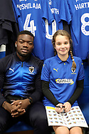AFC Wimbledon defender Deji Oshilaja (4), mascot during the EFL Sky Bet League 1 match between AFC Wimbledon and Southend United at the Cherry Red Records Stadium, Kingston, England on 24 November 2018.